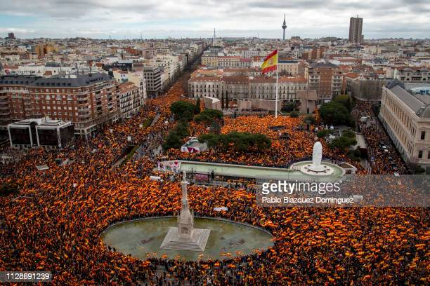 Protesters wave Spanish flags during a rightwing demonstration against prime minister Pedro Sanchez in Colon Square on February 10 2019 in Madrid...
