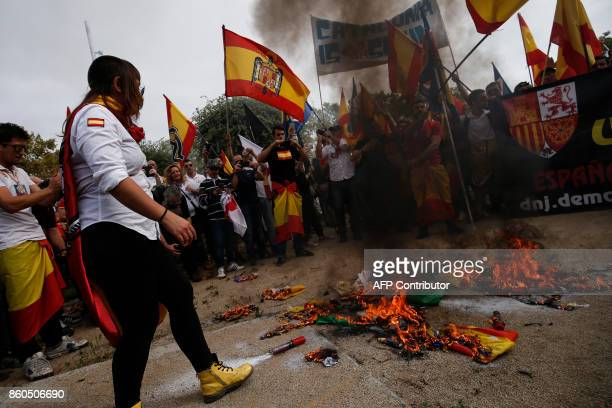 Protesters wave Spanish preconstitutional flags and burn 'Esteladas' Catalan proindependence flags during an ultraright wing antiseparatist...