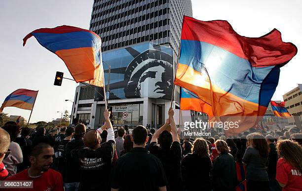Protesters wave the Armenian flag during a demonstration outside the Turkish Consulate on Wilshire Blvd in Los Angeles on April 24 to call for an end...