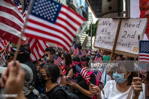 Protesters wave US flags as they gather ahead of a prodemocracy march on September 15 2019 in Hong Kong China Prodemocracy protesters have continued...