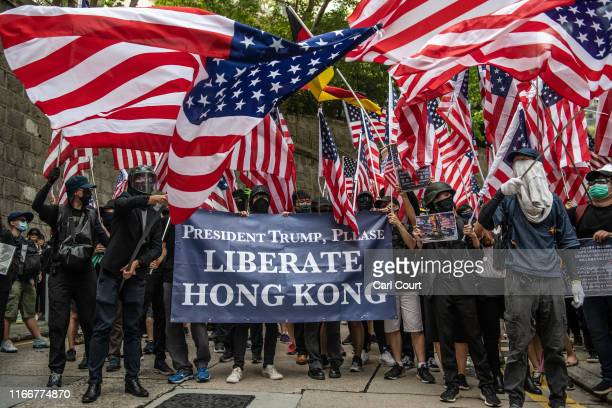 Protesters wave US flags outside the US consulate after delivering a petition on September 8 2019 in Hong Kong China Prodemocracy protesters have...
