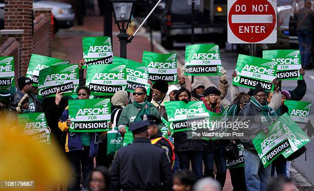 AFSCME protesters waved signs in the sightline of the speakers at the inaugural ceremony of Maryland Governor Martin J O' Malley at the Maryland...