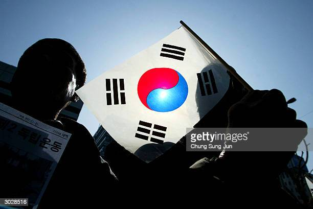 Protesters waves a national flag at an anti-Japan rally during the celebration of Independence Movement Day March 1, 2004 in Seoul, South Korea....