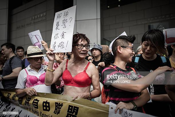 Protesters wear bras during a demonstration outside the police headquarters in Hong Kong on August 2 2015 The demonstrators gathered in support of a...
