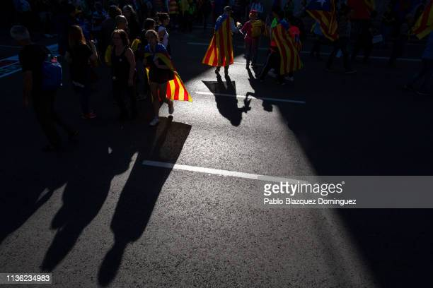 Protesters wear Catalan Independence flags before a demonstration titled 'Selfdetermination is not a crime' on March 16 2019 in Madrid Spain...