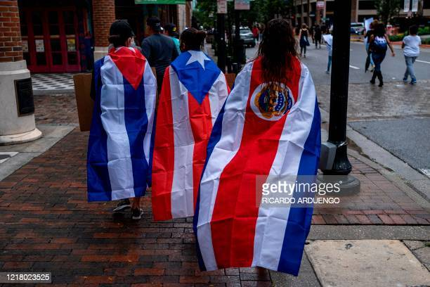 Protesters wear Cuban Puerto Rican and Costa Rican flags during a rally in response to the recent death of George Floyd in police custody in...