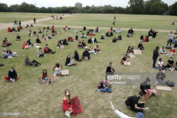 Protesters wear face masks and observe social distancing during a Black Lives Matter protest in Hyde Park on June 3 2020 in London United Kingdom The...