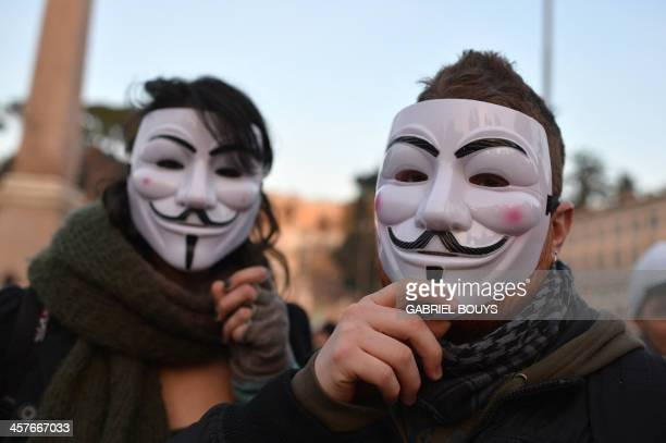 Protesters wear Guy Fawkes masks during a demonstration of the Forconi against austerity policies and the Italian government on December 18, 2013 in...