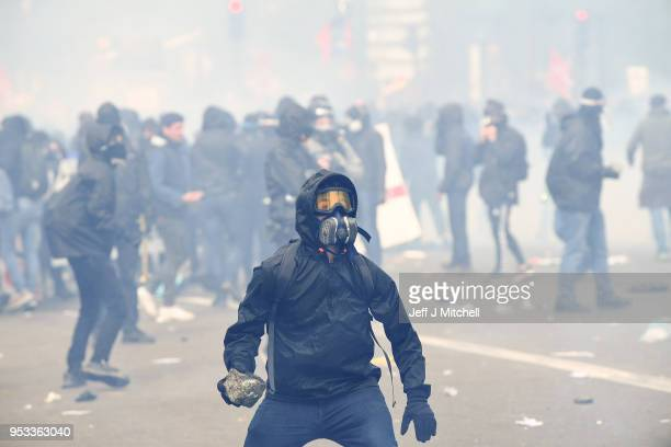 Protesters wear masks as thousands of people take to the streets during the May Day demonstrations on May 1 2018 in Paris France This month...