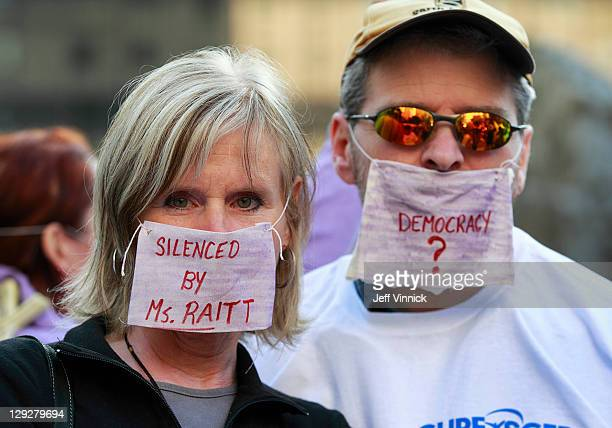 Protesters wear masks symbolizing muzzles over their mouths at the Vancouver Art Gallery as thousands of people participate in the Occupy Vancouver...