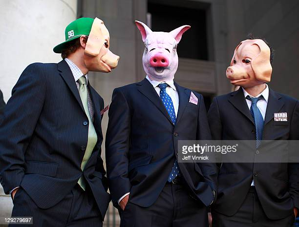 Protesters wear pig masks and business suits at the Vancouver Art Gallery as thousands of people participate in the Occupy Vancouver protest on...