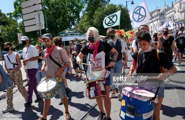 Protesters wear protective masks and hold signs and banners during a rally to demonstrate against Fascism, Nazism and racism on July 25, 2020 in...