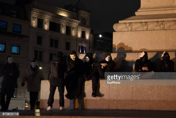 Protesters wear the iconic Guy Fawkes mask in Trafalgar Square during the anticapitalist 'Million Masks March' organised by the group Anonymous to...