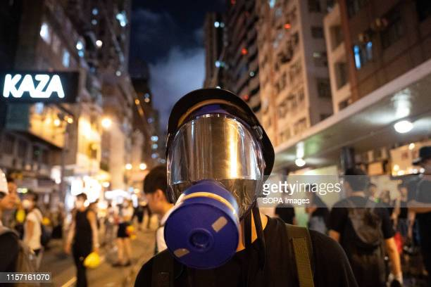 A protesters wearing a gas mask to protect himself from police tear gas The Hong Kong police has used tear gas and rubber bullets against protesters...