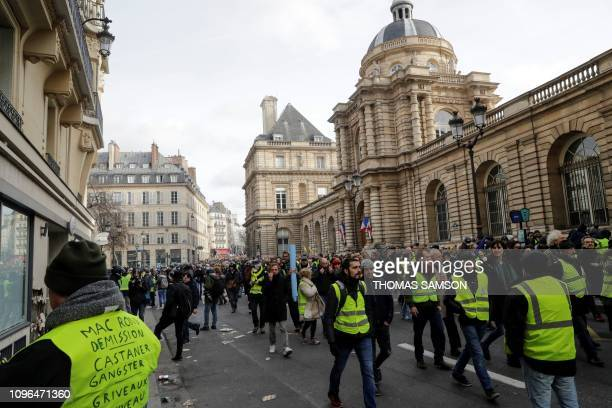 Protesters wearing a yellow vest demonstrate in front of the French Senate on February 9 during the 13th consecutive Saturday of antigovernment...