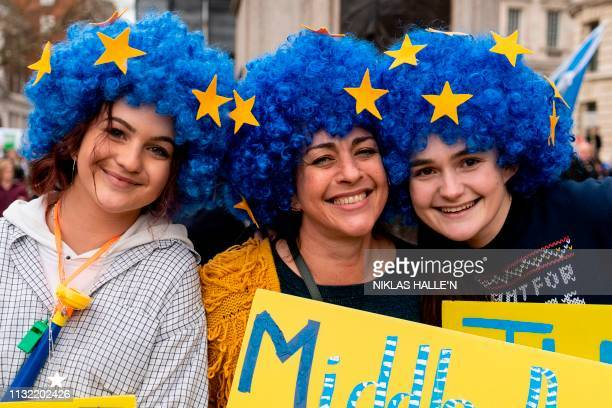 Protesters wearing European flag wigs attend a march and rally organised by the proEuropean People's Vote campaign for a second EU referendum in...