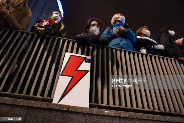 Protesters wearing face masks are seen listening to speeches during the demonstration. Tens of thousands of people took to the streets of Poland for...