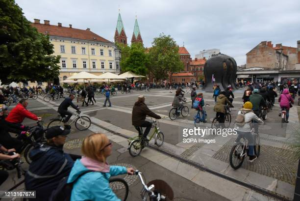 Protesters wearing face masks as a preventive measure ride bicycles at the Trg Svobode square during the demonstration. For the fourth Friday in a...
