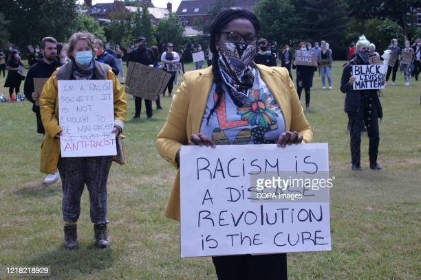"""Protesters wearing face masks hold placards during the demonstration. Over 300 """"Black Lives Matter"""" Protesters gathered peacefully in Wrexham, N...."""