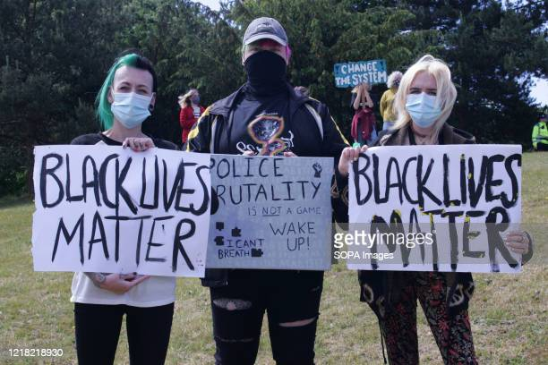 Protesters wearing face masks hold placards during the demonstration Over 300 Black Lives Matter Protesters gathered peacefully in Wrexham N Wales in...