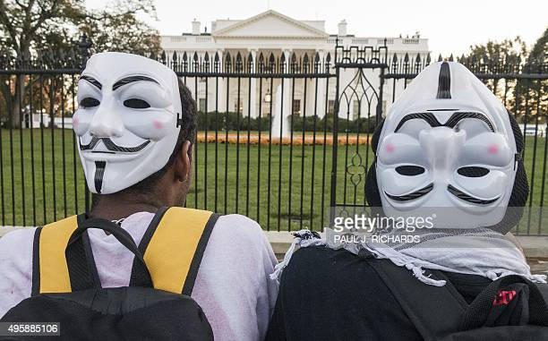 Protesters wearing Guy Fawkes mask stand near the White House during the Anonymous Million Mask March on the streets of downtown Washington DC on...