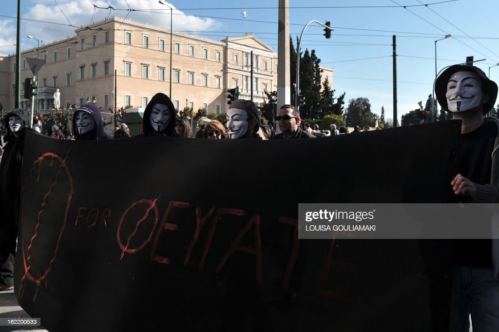 Protesters, wearing Guy Fawkes masks, carry a banner reading 'F for flee' participate in a demonstration in central Athens on February 20, 2013. Thousands of Greeks joined new anti-austerity protests on February 20, causing massive disruption to flights, ferries and hospital services in the debt-ridden country's first general strike this year. About 15,000 protesters took part in a Communist-organised demonstration in Athens and 20,000 more joined protests organised by other unions, according to police figures.