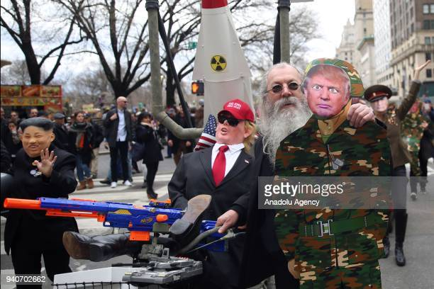 Protesters wearing masks mocking Donald Trump Vladimir Putin and Kim Jongun attend the April Fools Day Parade byTrump tower on the Fifth Avenue in...