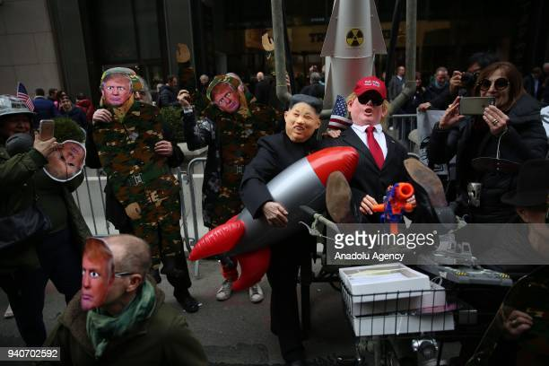 Protesters wearing masks of Donald Trump Vladimir Putin and Kim Jongun attend the April Fools Day Parade by Trump Tower on the Fifth Avenue in New...