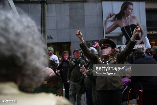 Protesters, wearing masks of Donald Trump, Vladimir Putin and Kim Jong-un, attend the April Fools Day Parade by Trump Tower on the Fifth Avenue in...