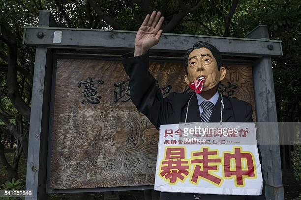Protesters wearing masks of Japanese Prime Minister Shinzo Abe AntiUS airbase demonstrators protest the US Airbase relocation to Henoko in front of...