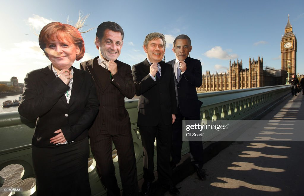 Protesters wearing masks of world leaders, Barack Obama, President of the United States, British prime minister Gordon Brown, French President Nicolas Sarkozy and German Chancellor Angela Merkel pose in front of the Houses of Parliament on November 3, 2009 in London, England. The protesters were campaigning for the leaders of developed nations to establish firm commitments to cutting CO2 at the global climate change negotiations in Copenhagen next month.