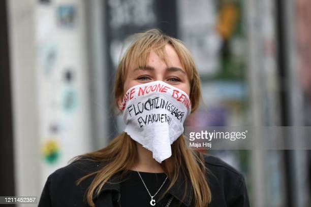 Protesters wearing protective face masks take part in a demonstration in Kreuzberg on May Day during the novel coronavirus crisis on May 1 2020 in...