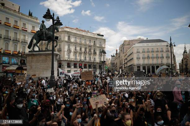 Protesters wearing protective masks as a precaution against COVID-19 pandemic gather in front of US Embassy in Madrid to march to Puerta del Sol...
