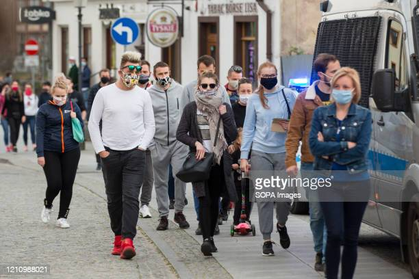 Protesters wearing protective masks march on the street as they take part during the demonstration Hundreds of polishGermany border residents protest...
