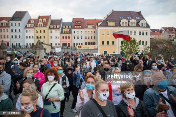 Protesters wearing protective masks march on the street during the demonstration. Hundreds of polish-Germany border residents protest against...