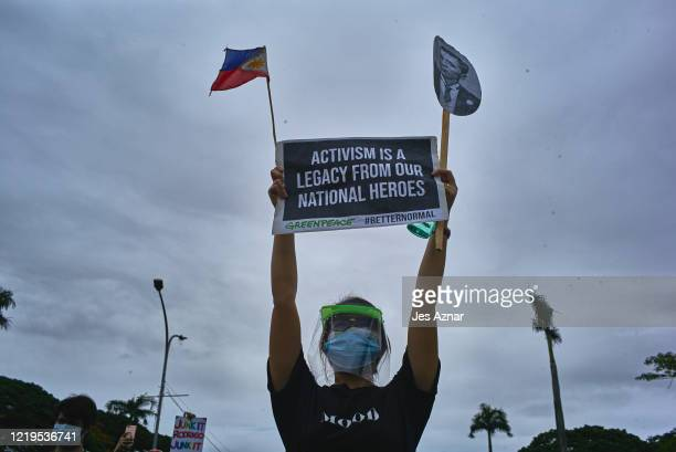 Protesters wearing protective masks participate in a rally to protest president Dutertes AntiTerror Bill on June 12 2020 in Manila Philippines...