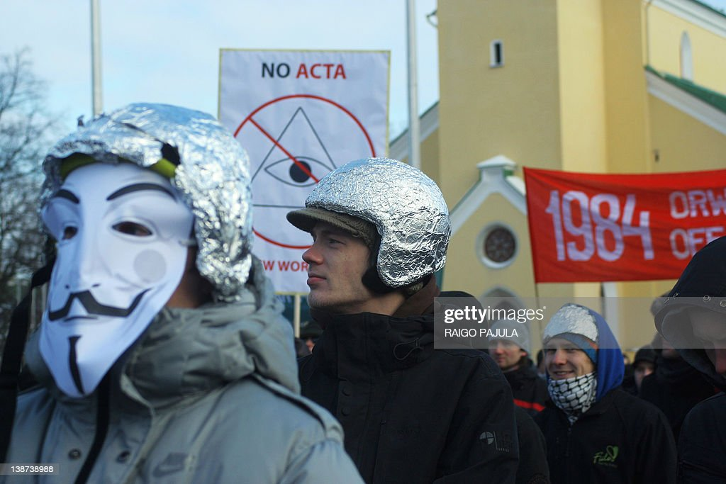 Protesters wearing tinfoil hats take part in a demonstration against controversial Anti-Counterfeiting Trade Agreement (ACTA) as part of an international day of action against the increasingly-contested accord, at the Freedom Square in central Tallinn on February 11, 2012. Thousands of people demontrated despite freezing temperature, many of them were wearing tinfoil hats, after Estonian Prime Minister Andrus Ansip came under fire on February 9 after suggesting that critics of the controversial Anti-Counterfeiting Trade Agreement must be on drugs, adding that 'It might be helpful to put tinfoil in your hat,' referring to the belief of some UFO-watchers that it wards off alien mind-control. ACTA's aim is to beef up international standards for intellectual property protection, for example by doing more to fight counterfeit medicine and other goods. But it is ACTA's potential role in cyberspace that has caused outcry online and on the streets.