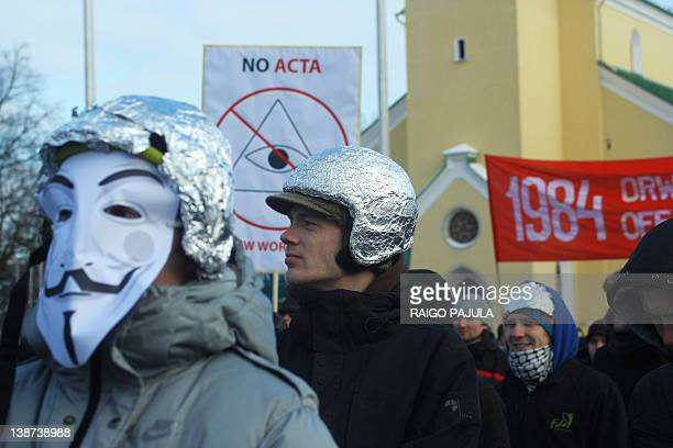 Protesters wearing tinfoil hats take part in a demonstration against controversial AntiCounterfeiting Trade Agreement as part of an international day...