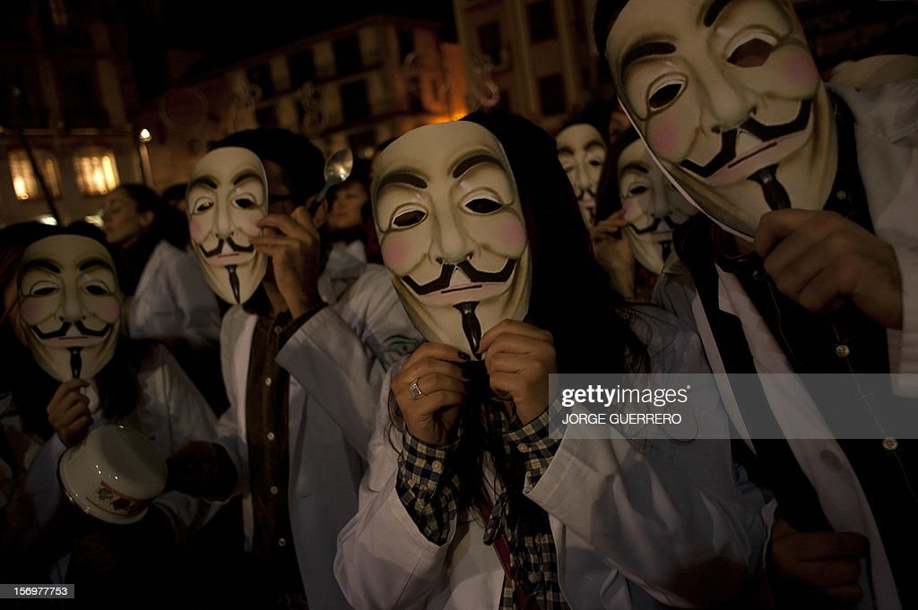 Protesters wearing white coats and Guy Fawkes masks take part in a protest of health workers to denounce budget cuts and privatisations in health services, in Malaga of November 26, 2012. The health sector has been hard hit by the austerity policies implemented by the rightwing government of Mariano Rajoy, which is trying to cut the public deficit in the eurozone's fourth largest economy. The CESM medical union announced a strike for today and November 27 to be repeated on December 4 and 5.