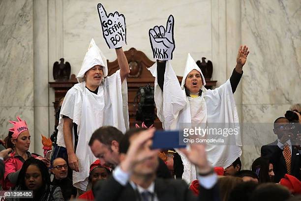 Protesters wearing white sheets shout at Sen Jeff Sessions as he arrives for his confirmation hearing to be the US attorney general Senate Judiciary...