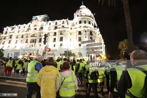 Protesters wearing yellow jackets protesting against the rising of the fuel and oil prices gather in front of the Negresco hotel on the 'Promenade...