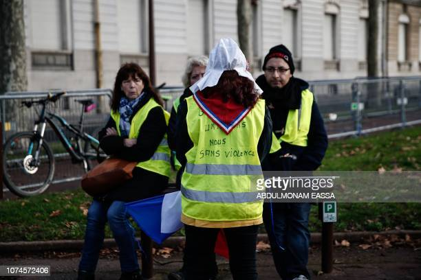 Protesters wearing 'Yellow Vests' gather in a street near the Chateau de Versailles in Versailles outside Paris on December 22 2018 The 'Yellow...