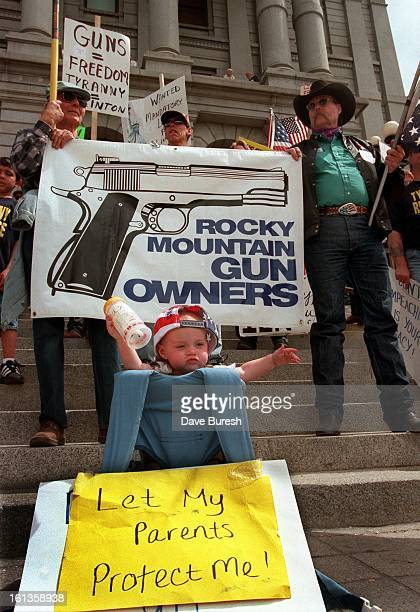 Protesters who call themselves the Tyranny Response Team gathered on the West Steps of the Capitol. In the foreground is 9 month old Jax Phalen . In...