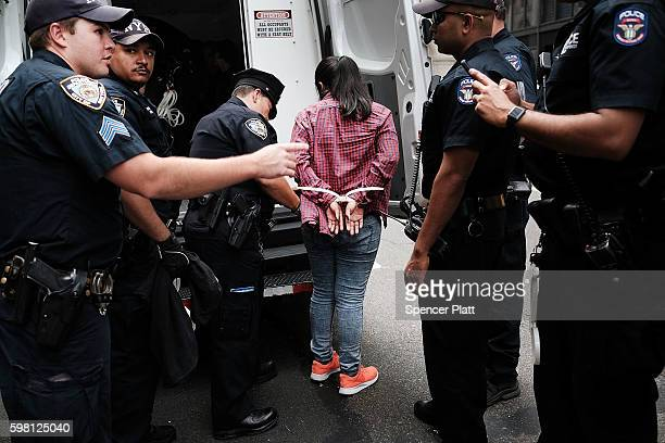 Protesters who had blocked the entrance to Trump Tower in Manhattan are arrested on August 31 2016 in New York City The action called 'hecho por...