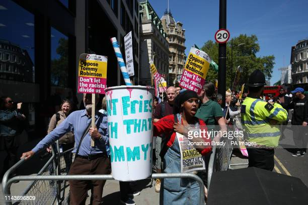 Protesters who oppose Tommy Robinson gather outside the Old Bailey in the City of London ahead of the latest stage of a case against the former EDL...