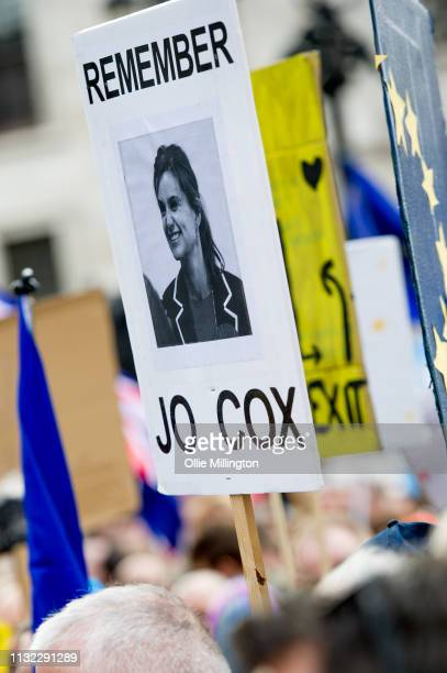 Protesters with a poster remembering Helen Joanne Cox a British politician who served as the Member of Parliament for Batley and Spen from her...