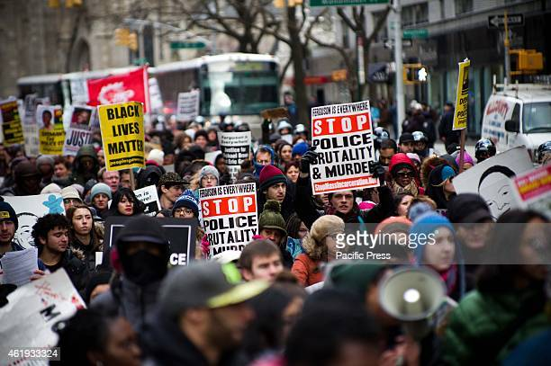 Protesters with antipolice brutality placard Hundreds of protesters in Harlem during Martin Luther King Jr Day demonstration gathered at Malcolm X...