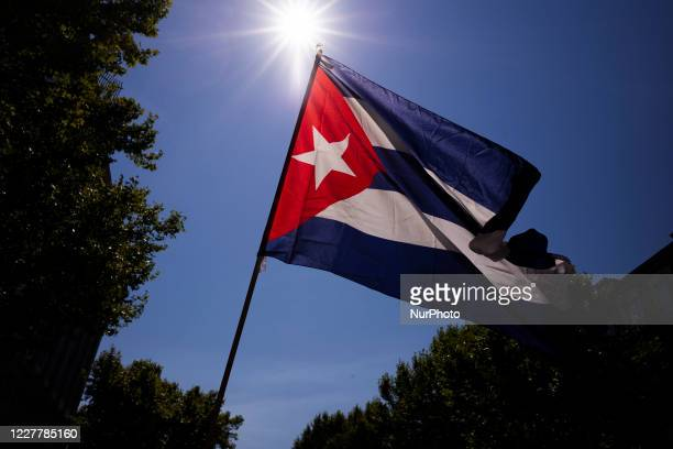 Protesters with Cuban flags during the demonstration with the slogan 'Cuba saves lives 60 years of internationalism' for July 26 the day of Cuba's...