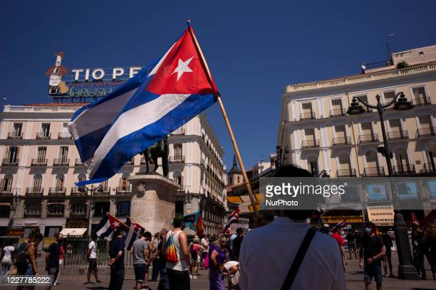 Protesters with Cuban flags during the demonstration with the slogan 'Cuba saves lives: 60 years of internationalism' for July 26, the day of Cuba's...