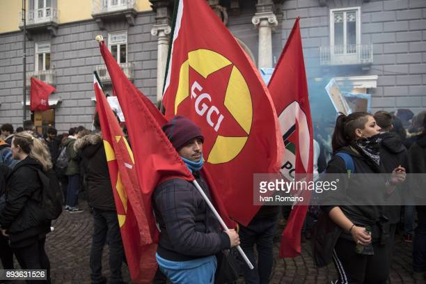 Protesters with flags from the Italian Young Comunist Federation near the Confcommercio during demonstration in the streets of Naples against the...